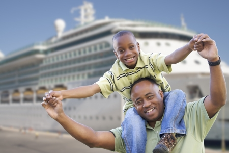 family vacation: Happy African American Father and Son in Front of Cruise Ship.