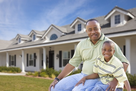 new home family: Playful African American Father and Son In Front Yard of Home.