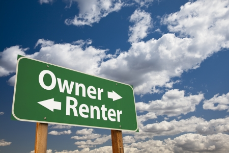 owning: Owner, Renter Green Road Sign Over Dramatic Clouds and Sky. Stock Photo