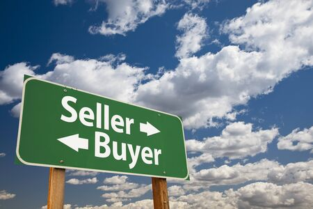 Seller, Buyer Green Road Sign Over Dramatic Clouds and Sky. Stok Fotoğraf