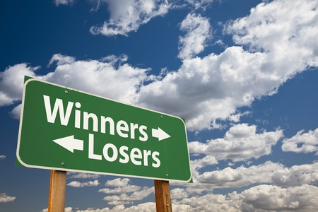 losers: Winners, Losers Green Road Sign Over Dramatic Clouds and Sky.