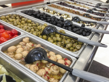 abundant: Marinating Olive Variety Buffet in Delicatessen.