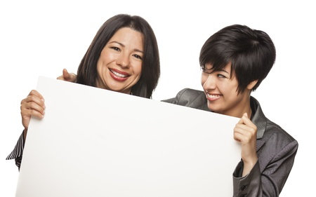 Attractive Mixed Race Mother and Daughter Holding Blank White Sign Isolated on a White Background. photo