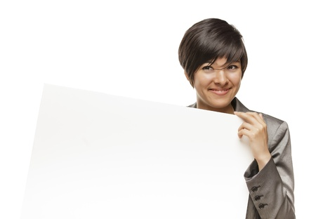 Attractive Mixed Race Young Adult Female Holding Blank White Sign in Front of Her Isolated on a White Background. photo