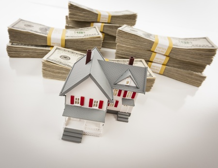 downpayment: Stacks of One Hundred Dollar Bills with Small House.