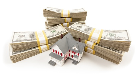 escrow: Stacks of One Hundred Dollar Bills with Small House.