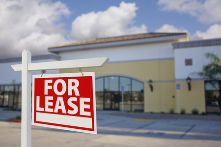 for rent sign: Vacant Retail Building with For Lease Real Estate Sign in Front.