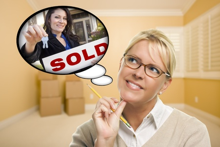 selling house: Attractive Woman In Empty Room with Thought Bubble of Agent and Sold Sign Handing Over New Keys. Stock Photo