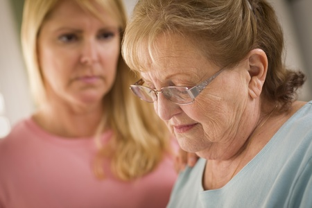 soothe: Young Adult Woman Consoles Sad Senior Adult Female.