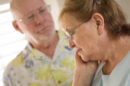 consoling: Senior Adult Man Consoles Sad Senior Adult Female. Stock Photo