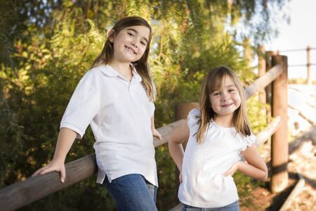 Pretty Young Children Sisters Portrait Outside. Stock Photo - 19126436