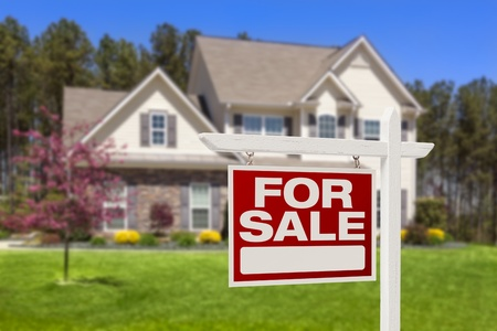 first move: Home For Sale Real Estate Sign and Beautiful New House  Stock Photo