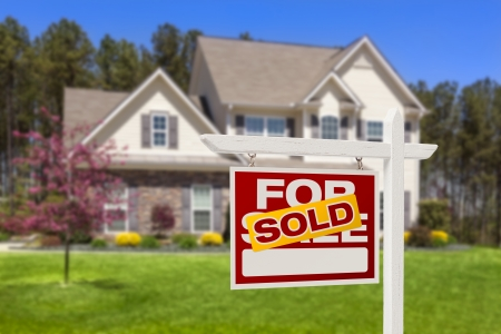 selling house: Sold Home For Sale Real Estate Sign and Beautiful New House  Stock Photo