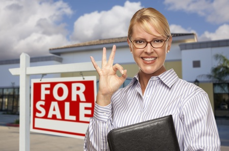 vacant sign: Smiling Businesswoman with Okay Sign In Front of Vacant Office Building and For Sale Real Estate Sign.
