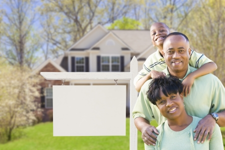 room for text: African American Family In Front of Blank Real Estate Sign and New House - Ready for Your Own Text.