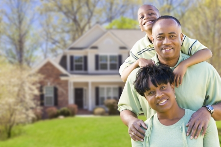 front or back yard: Happy African American Family In Front of Beautiful House.