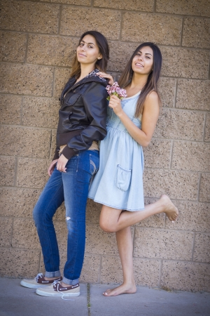 Two Beautiful Mixed Race Twin Sisters Portrait Outdoors. photo