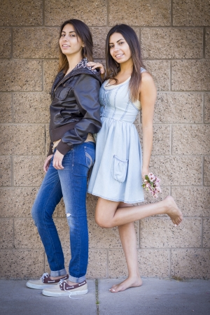 palestinian: Two Beautiful Mixed Race Twin Sisters Portrait Outdoors. Stock Photo