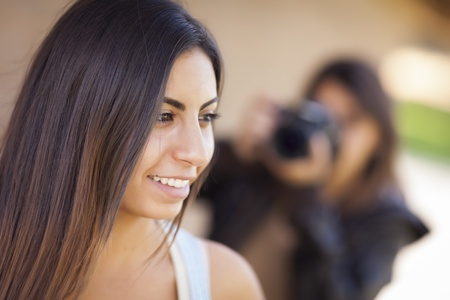palestinian: Attractive Young Adult Mixed Race Female Model Poses for a Photographer Outside.