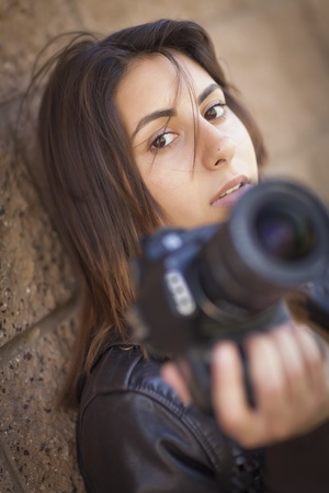 palestinian: Attractive Mixed Race Young Adult Female Photographer Against Wall Holding Camera. Stock Photo