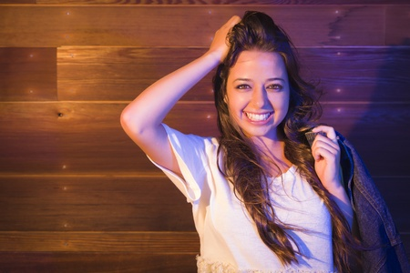 lustrous: Portrait of a Pretty Mixed Race Young Adult Woman Against a Lustrous Wooden Wall Background.