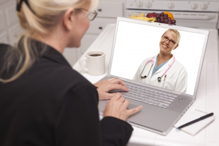 Woman Using Laptop having Online Chat with Doctor on Screen. Stock Photo