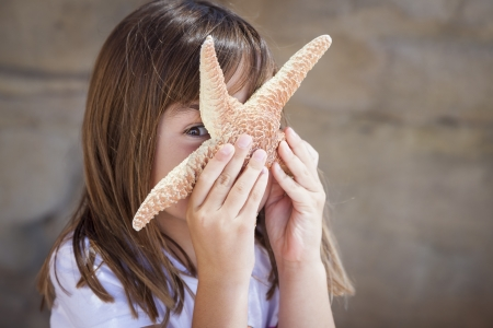 Young Pretty Girl Playing with Starfish. Stock Photo - 20145643