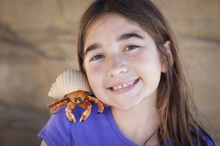 Young Pretty Girl Playing with Toy Hermit Crab. Stock Photo - 20145642