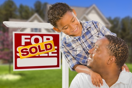 Happy Mixed Race Father and Son In Front of Sold Real Estate Sign and New House Stock Photo - 20688611