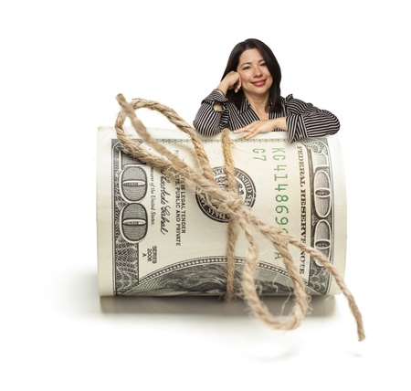Attractive Hispanic Woman Leaning on a Roll Of One Hundred Dollar Bills Isolated on a White Background  photo