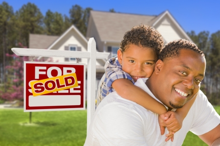 Happy Mixed Race Father and Son In Front of Sold Real Estate Sign and New House Stock Photo - 20688663