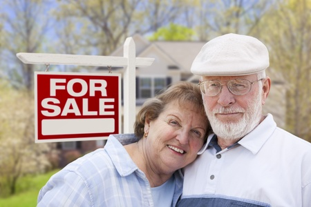 Happy Senior Couple Front of For Sale Real Estate Sign and House. Stock Photo - 20758442