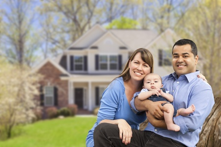 couple home: Happy Mixed Race Couple in Front of Beautiful House.