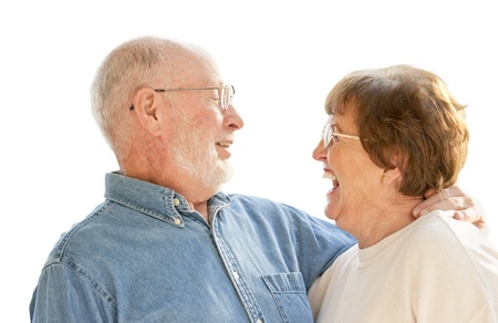 Affectionate Happy Senior Couple Laughing Together Isolated on White. photo