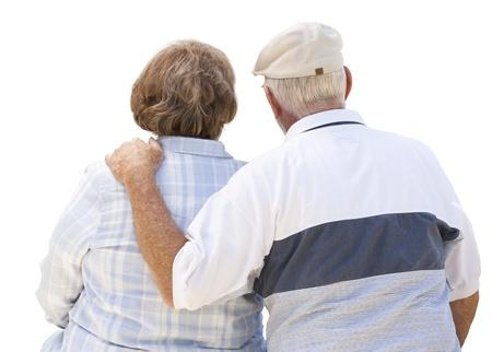 Happy Senior Couple From Behind Isolated on White. photo