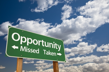Opportunity Missed and Taken Green Road Sign Over Dramatic Blue Sky and Clouds. Stock Photo