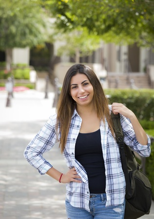 Attractive Young Mixed Race Female Student Portrait on School Campus with Backpack.
