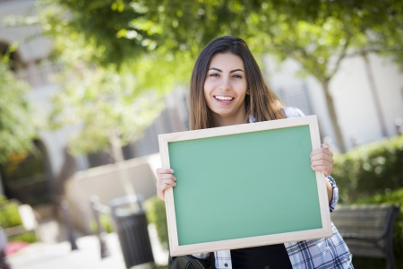 18's: Portrait of An Attractive Excited Mixed Race Female Student Holding Blank Chalkboard and Carrying Backpack on School Campus.