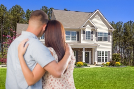 Affectionate Military Couple Looking at Nice New House. photo