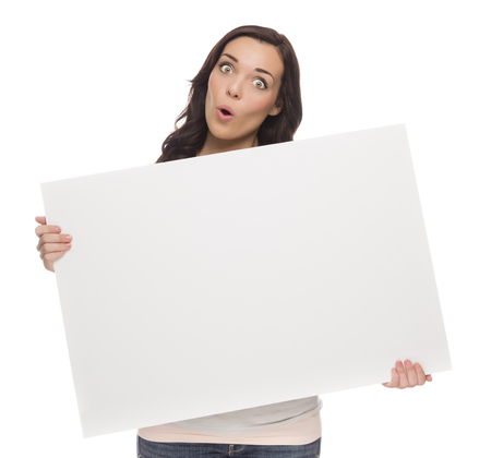 holding a sign: Beautiful Mixed Race Female Holding Blank Sign  Stock Photo