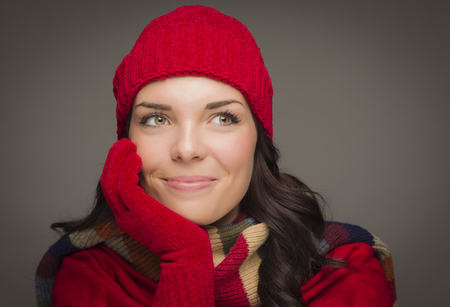 mexican girl: Happy Mixed Race Woman Wearing Winter Hat and Gloves Looking to the Side on Gray Background. Stock Photo