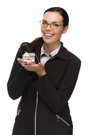 first time buyer: Mixed Race Woman Holding Small House Isolated on White . Stock Photo