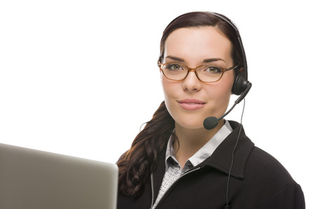Helpful Mixed Race Receptionist In Front of Computer Wearing Phone Head-set Isolated on White . photo