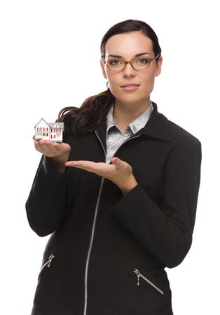 Mixed Race Businesswoman Holding Small House to the Side Isolated on a White Background.