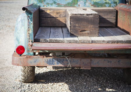 days gone by: Abstract of Old Rusty Antique Truck Bed in a Rustic Outdoor Setting.