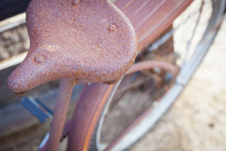 days gone by: Abstract of Old Rusty Antique Bicycle Seat in a Rustic Outdoor Setting.  Stock Photo