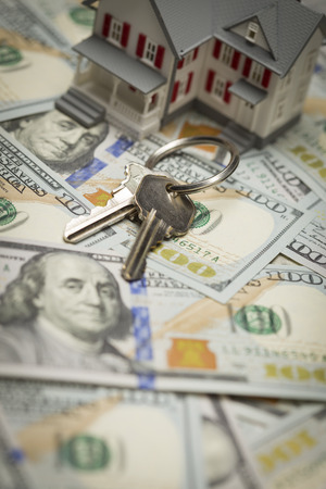 escrow: Small Model House and Keys on Newly Designed U.S. One Hundred Dollar Bills.
