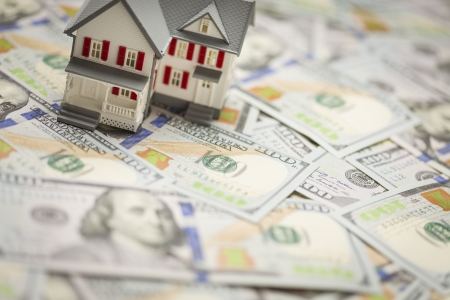 escrow: Small Model House on Newly Designed U.S. One Hundred Dollar Bills. Stock Photo