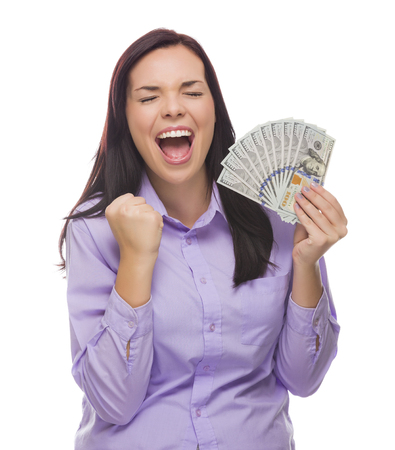 Excited Mixed Race Woman Holding the Newly Designed United States One Hundred Dollar Bills Isolated on a White Background. photo