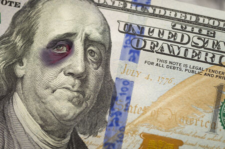 Bruised, Battered and Black Eyed Ben Franklin on the Newly Designed United States One Hundred Dollar Bill. photo